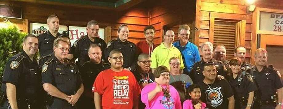 "On July 21, the men and women from the Harris County Sheriff Ron Hickman's Office participated in the statewide ""Tip A Cop"" sponsored by Texas Roadhouse through the Special Olympics of Texas."