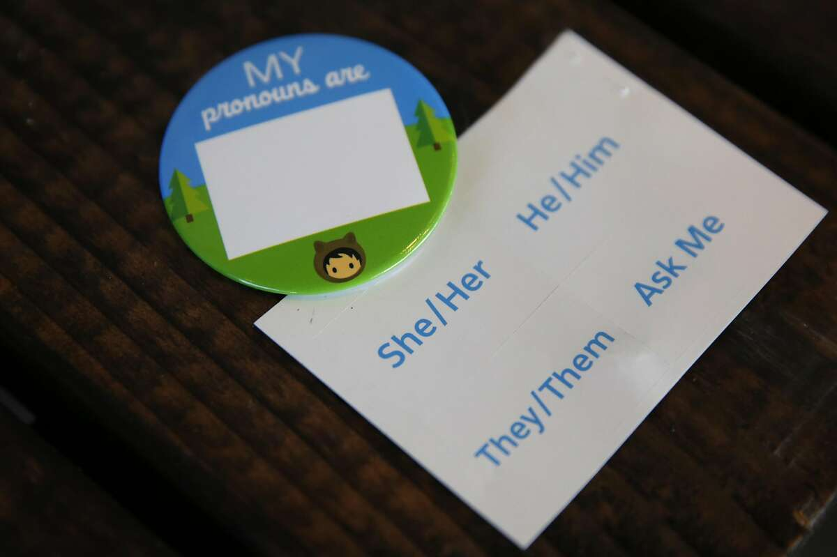 A pin given out inside the Dreamforce bags allows people to designate their pronoun during the Dreamforce conference in the Moscone West building Oct. 5, 2016 in San Francisco, Calif.