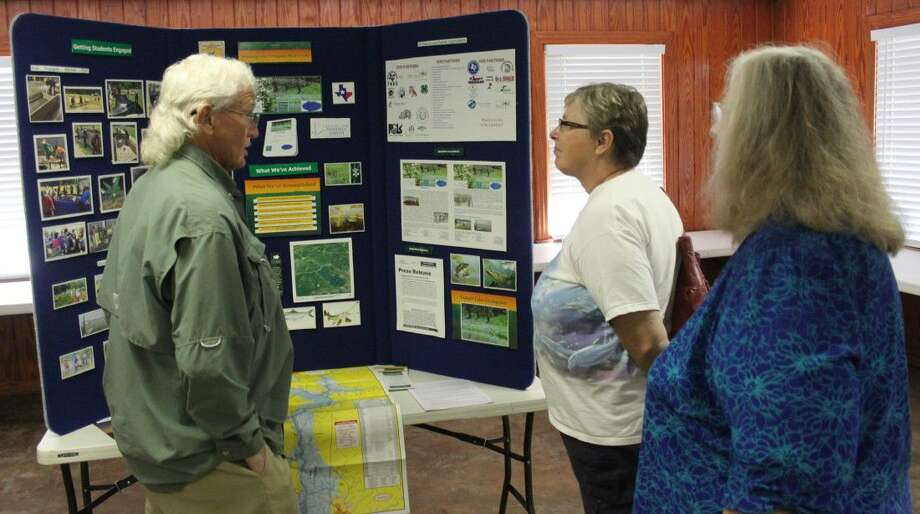 "Tom McDonough (left) presents information on the ""Bringing Lake Livingston Back to Life"" project, which has participation from the San Jacinto County Master Gardeners. Photo: Jacob McAdams"