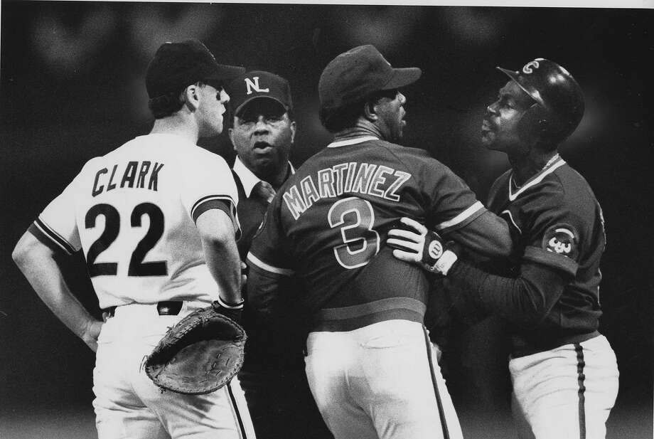 San Francisco Giants 1st baseman Will Clark and Shawon Dunston, being restrained here by coach Jose Martinez would get in a beef after Game 4 against the Chicago Cubs, October 8, 1989. The Giants would clinch in Game 5 of National League Championship Series at Candlestick. They won the series 4-1. Photo: Brant Ward, The Chronicle