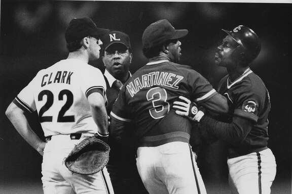 San Francisco Giants 1st baseman Will Clark and Shawon Dunston, being restrained here by coach Jose Martinez would get in a beef after Game 4 against the Chicago Cubs, October 8, 1989. The Giants would clinch in Game 5 of National League Championship Series at Candlestick. They won the series 4-1.