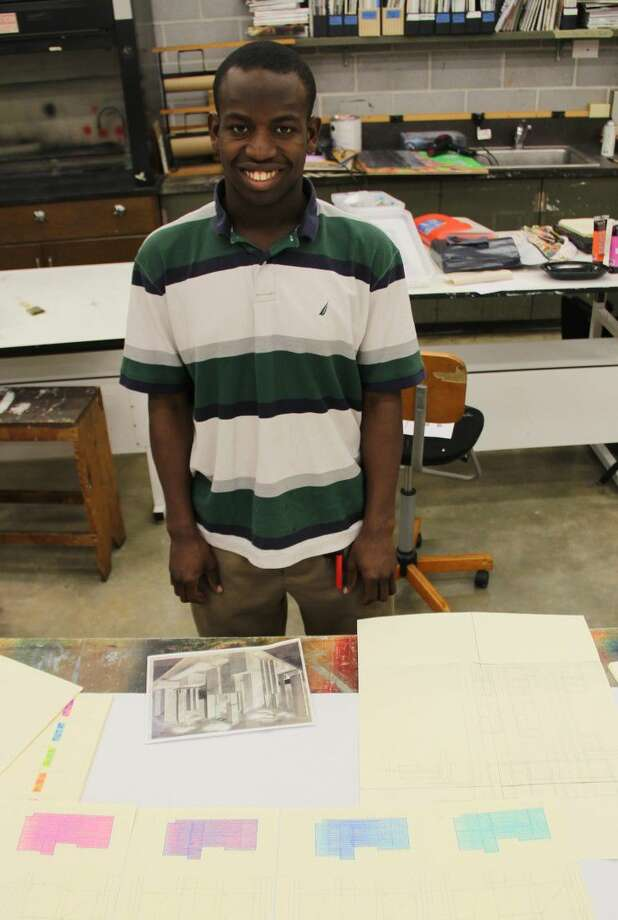 Continuing education art student Adam Cline shows off his work.