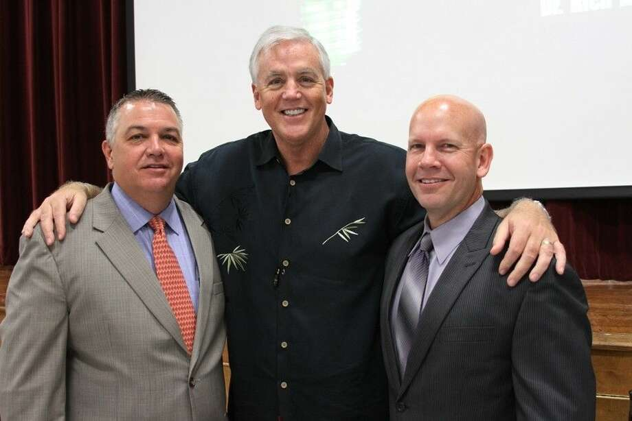 """World-renowned speaker and best-selling author Dr. Rich Allen addressed teachers on """"Green Light Classrooms"""" as part of the COCISD District Convocation on Monday, Aug. 18. Pictured, from left to right, are Superintendent Jerry Gibson, Dr. Rich Allen and Asst. Superintendent Dr. Byron Terrier. Photo: CASSIE GREGORY"""