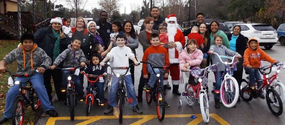 "Children from Patton Village were presented with bicycles and other holiday toys during a ""Breakfast with Santa"" event on Dec. 23. The children have all been involved in domestic abuse cases that have been worked by the Patton Village Police Department. Photo: Stephanie Buckner"