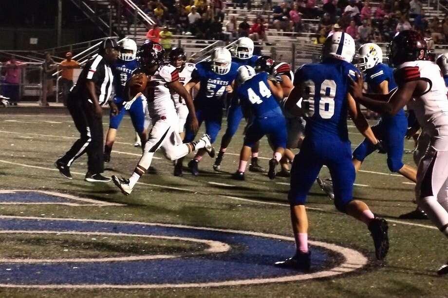 Kirbyville running back Ty Dennis (8) scores the first of the Wildcats' seven touchdowns at Hardin Friday night, Oct. 23, 2015. Photo: Casey Stinnett