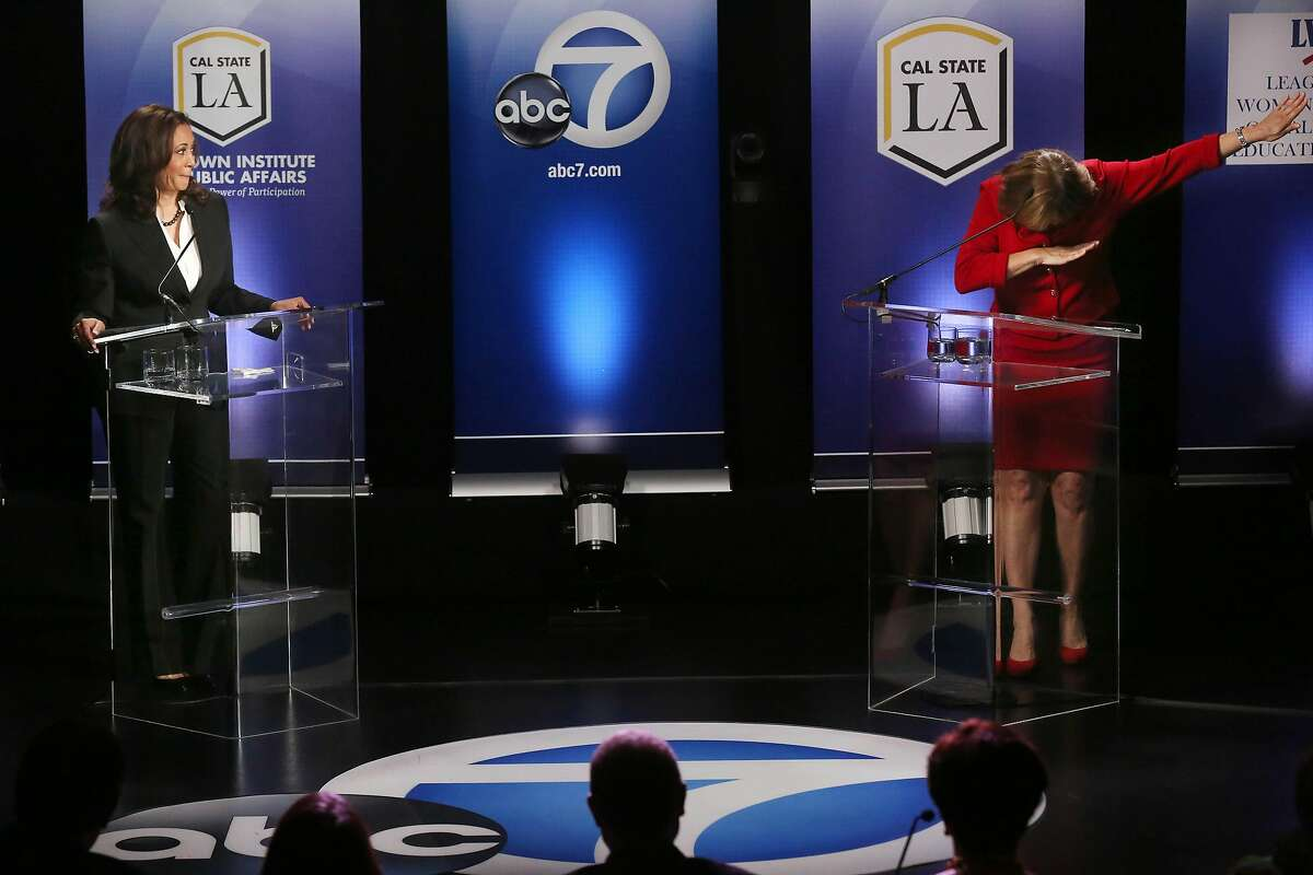 US Senate candidate Kamala Harris watches as fellow candidate Loretta Sanchez dabs at the end of her closing statement during their one and only debate being held at Cal State LA.