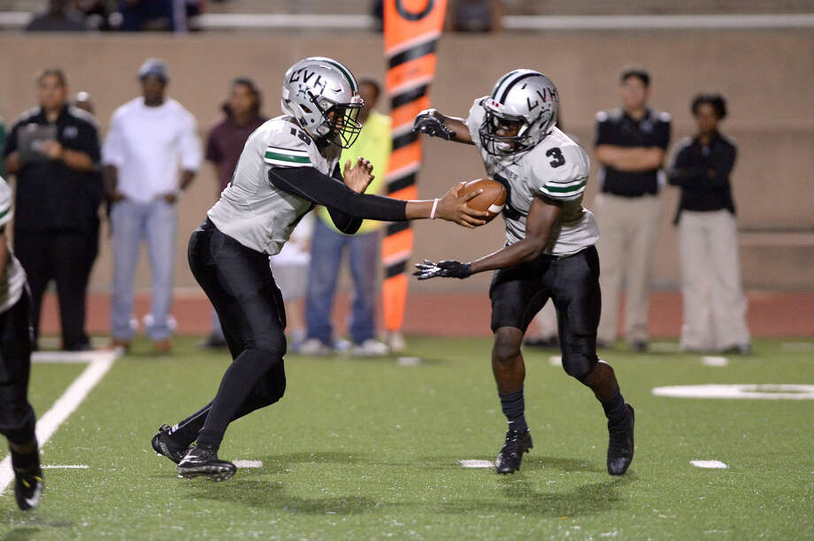 Hightower quarterback Neiko Hollins hands off to Trevon Estes against Alief Taylor, Oct. 24 at Crump Stadium. The Hurricanes finished undefeated in the regular season, winning their third consecutive district championship. To view or purchase this photo and others like it, visit HCNpics.com. Photo: Craig Moseley