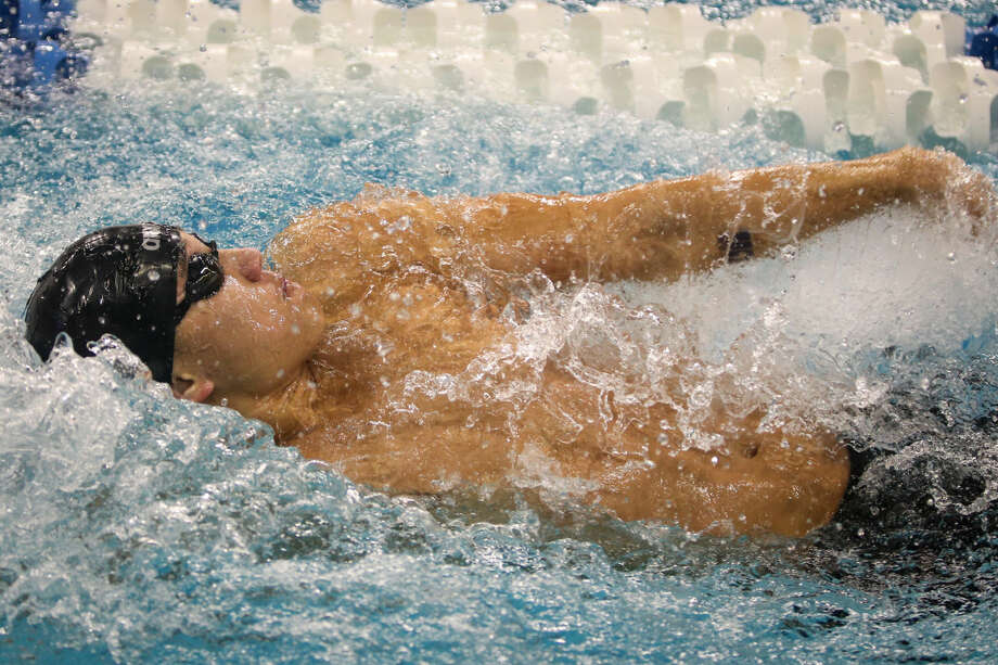 Clements competes in the boys 200-yard medley relay during the Class 6A finals of the UIL State Swimming & Diving Championships at the Lee and Joe Jamail Texas Swimming Center. To view this photo and others like it from the championships, go to HCNPics.com. Photo: Michael Minasi