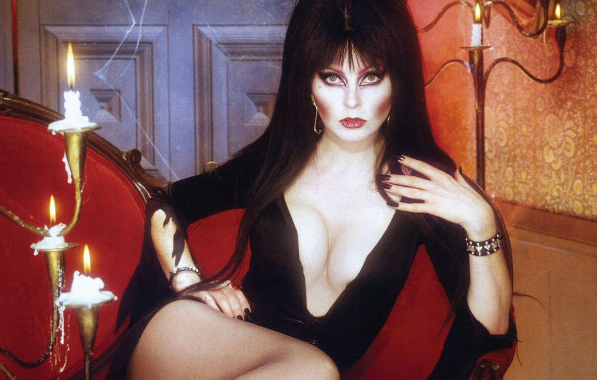 PHOTOS: 35 years of Elvira, Mistress of the Dark  This year marks 35 years since actress Cassandra Peterson first donned a black bouffant wig, spooky eye makeup, and a plunging black dress to portray the spunky and buxom Elvira, Mistress of the Dark. Click through the gallery to see more pictures of the Queen of Halloween...