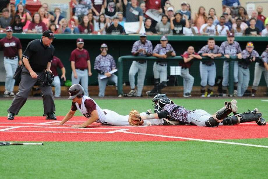 Cy-Fair junior Johnny Rizer slides safely into home during the Bobcats' 3-2 Game 2 loss to Pearland on Friday in the regional semifinals. Photo: Submitted Photo