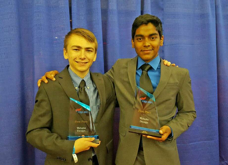 Cy-Fair students Michael Peroutek, left, and Koustubh Nyshadham display their first-place trophies in the Web Design competition at the Future Business Leaders of America (FBLA) National Leadership Conference.