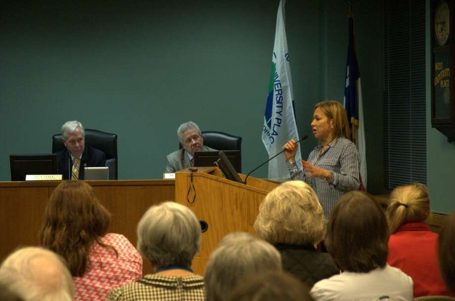 Resident Heidi Dugan expresses concerns about transparency from the council members at Monday's meeting.