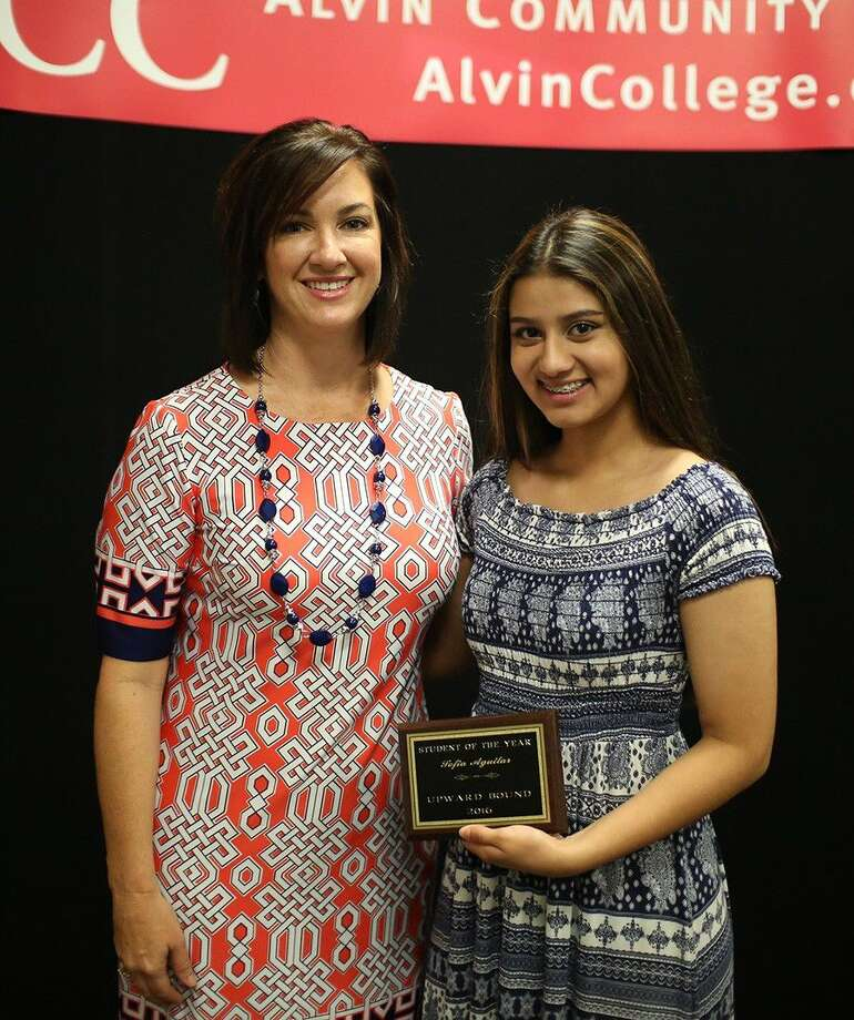 ACC Upward Bound student Sofia Aguilar, right, is recognized as the program's Student of the Year by director Regan Metoyer.