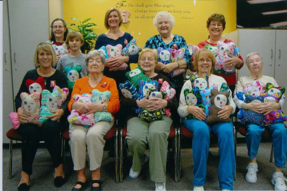 The Hug a Bear group at Lord of Life Church has been making bears for children who are patients at Memorial Hermann The Woodlands Hospital for almost 20 years. The group is the last of those founded by churches int the area to offer this ministry. Pictured from left are Sue Mohring, Annette Haut, Eli Rose, Jane Bauer, Lisa Rose, Patty Bronnoco, Vi Berge, Jan Hoyer, JoAnn Johnson and Ellen Rinker.