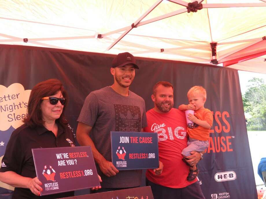 Astros shortstop Carlos Correa with Mattress Firm CEO Ken Murphy (right) and Houston Children's Charity Executive Director Laura Ward at Saturday's Restless for the Cause event. The event donated 500 mattresses to Houston-area children in need Photo: Photo(s) By Rosana Acevedo