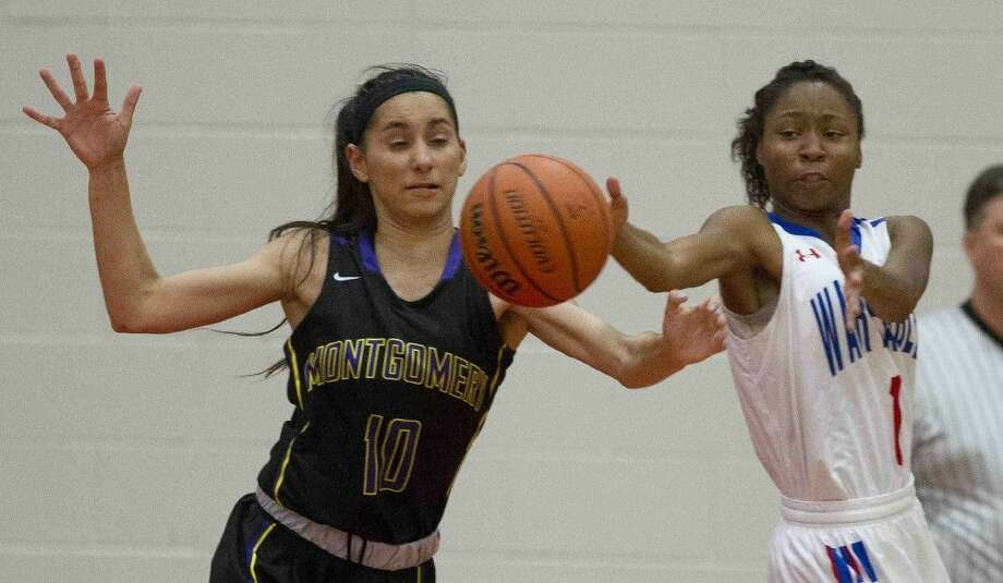 Oak Ridge small forward Jasmine Handy defelects a pass away from Montgomery shooting guard Veronica Thayer during the third quarter of a girls basketball game Tuesday, Dec. 8, 2015, in Oak Ridge.