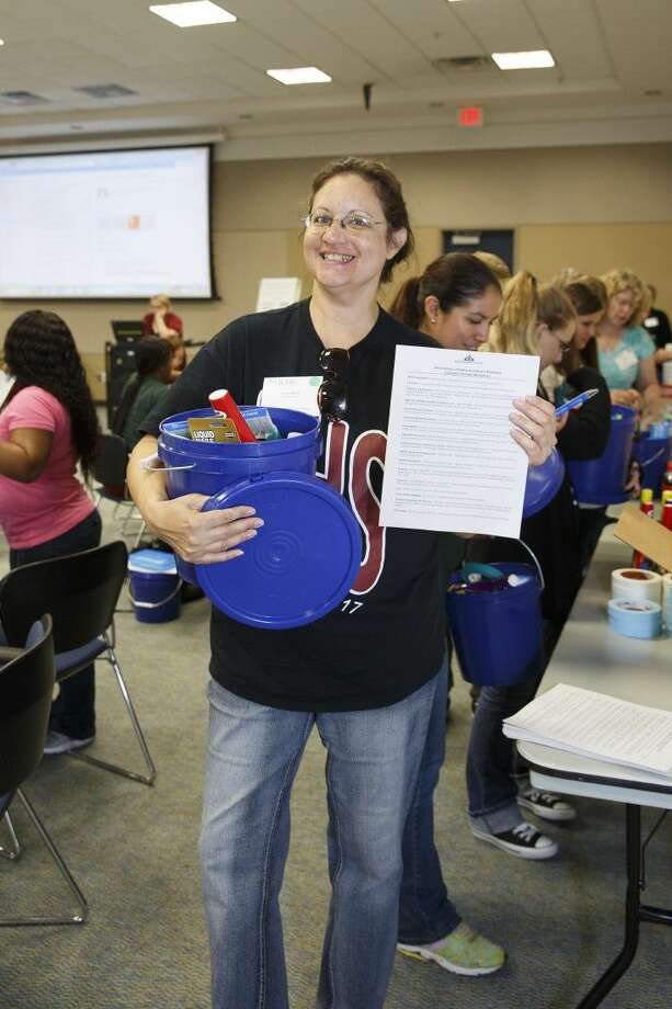 Pearland High teacher Karen Nickel gathers her bucket of items produced locally through Houston area chemical plant manufacturing.