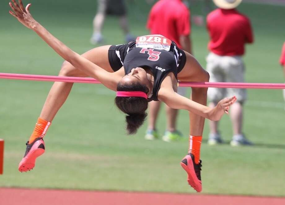 South Houston's Chelsie Decoud attempts to clear the bar during Saturday morning's 5A state championship for the girls' high jump. She settled for for fourth place with an effort of 5-6. Photo: Alan Warren