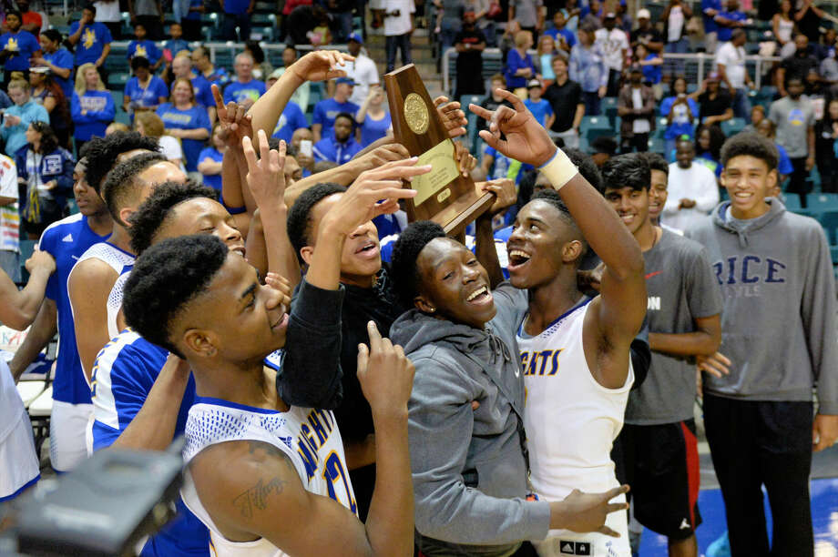 Elkins celebates its victory against Beaumont Ozen at the UIL Conference 5A Region III Championship, March 5 at the Leonard Merrell Center in Katy. The Knights advanced to their first state final. View this and additional photos at HCNPics.com. Photo: Craig Moseley