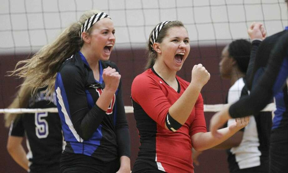 Oak Ridge's Victoria Harris, left, and Raigen Cianciulli celebrate during a match against Willis on Thursday in the Magnolia Volley-Battle. To view or purchase this photo and others like it, visit HCNpics.com.