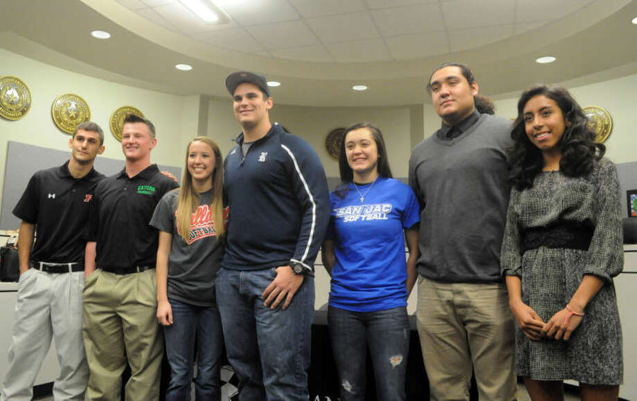 Ty Ewart, Brett Wright, Alex Eppinette, Cory Klingler, Jamie Henk, Josh Cuellar-Torres and Evelyn Chavez all signed National Letters of Intent at a signing day ceremony on Wednesday. Photo: Keith MacPherson