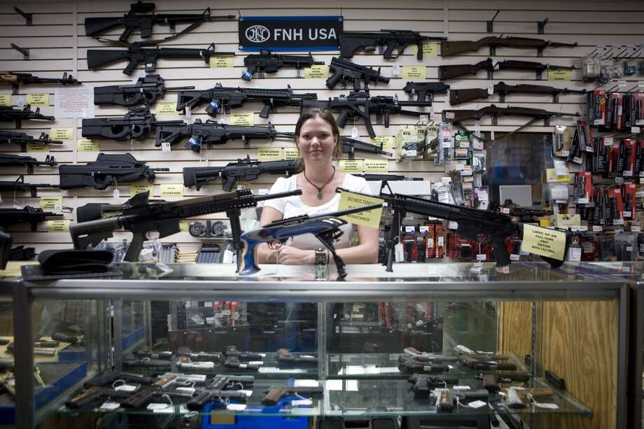 Gun sales are down since Trump's been in office.>>Click to see how Texas gun laws have changed. Photo: Gilles Mingasson/Getty Images