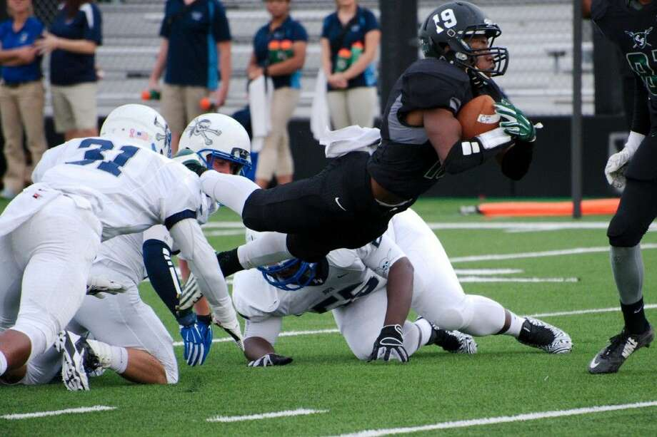 Clear Falls wide receiver Dante Goodner lunges forward for yardage in the Knights' game against Brazoswood Saturday afternoon. Photo: KIRK SIDES