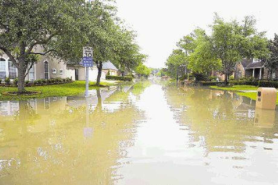 Texans who suffered damage to their home or personal property from the April or May of this year's floods are encouraged to register with FEMA before the deadline Photo: Tony Gaines
