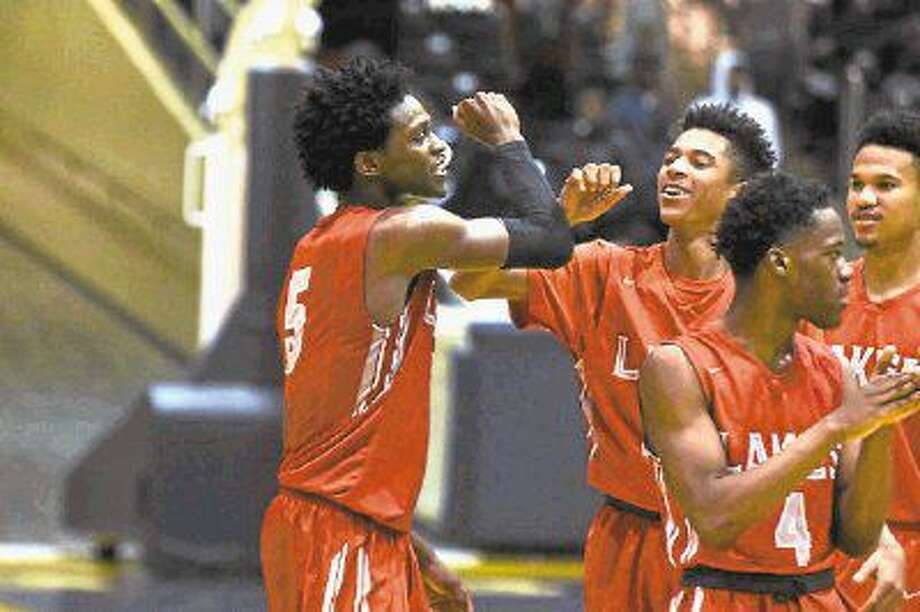 Cypress Lakes senior guard De'Aaron Fox celebrates with his teammates after the 75-72 playoff win against Bellaire Friday, February 26, 2016, at the Don Coleman Coliseum. Fox graduated in May, leaving Cy Lakes and Olatunbosun looking to replace his 31.3 points per game. Photo: Tony Gaines