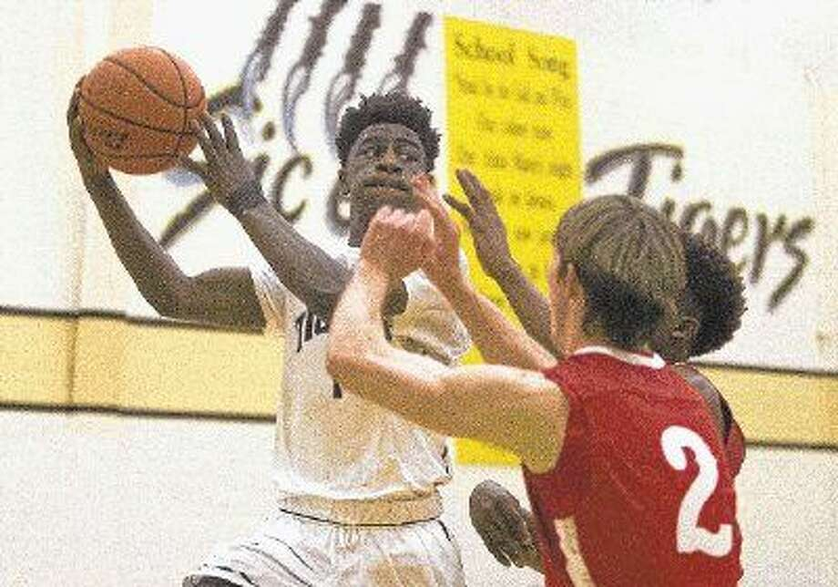 Conroe guard Jay Lewis looks to pass during a boys basketball game Tuesday in Conroe. Conroe defeated Tomball 51-48. To purchase this photo and other like it it, visit HCNpics.com Photo: Jason Fochtman