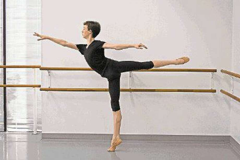 Finn Adams, an incoming sophomore at Cypress Woods High School, holds an arabesque pose during a rehearsal at the Houston Repertoire Ballet. Adams is one of five annual scholarship winners to attend the Central Pennsylvania Youth Ballet.