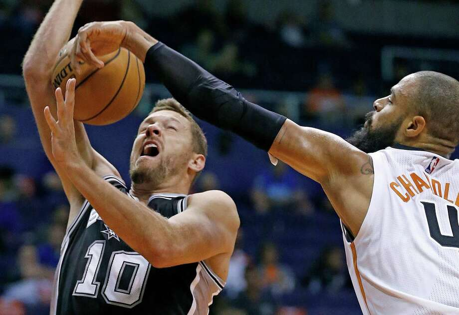 Spurs' David Lee (10) has his shot blocked by the Suns' Tyson Chandler during the first half of a preseason game on Oct. 3, 2016, in Phoenix. Photo: Ross D. Franklin /Associated Press / Copyright 2016 The Associated Press. All rights reserved.