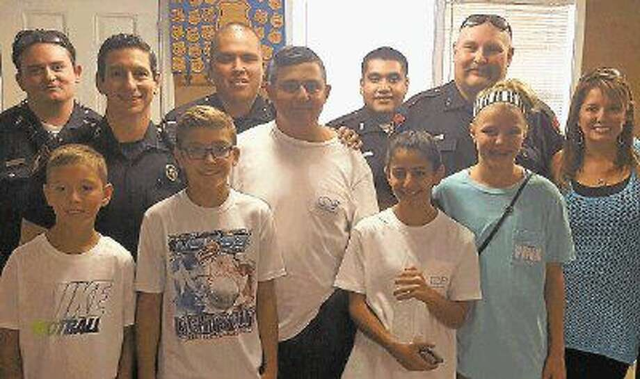Area mothers and their children visit the Precinct 4 Constable's office located on Mueschke Road to provide a fajita lunch for the deputies. Photo: Submitted Photo