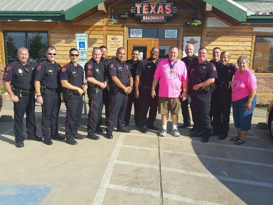 "Harris County Constable Mark Herman's office participated in the Law Enforcement Torch Run for Special Olympics ""Tip a Cop"" at the Texas Road House Restaurant."