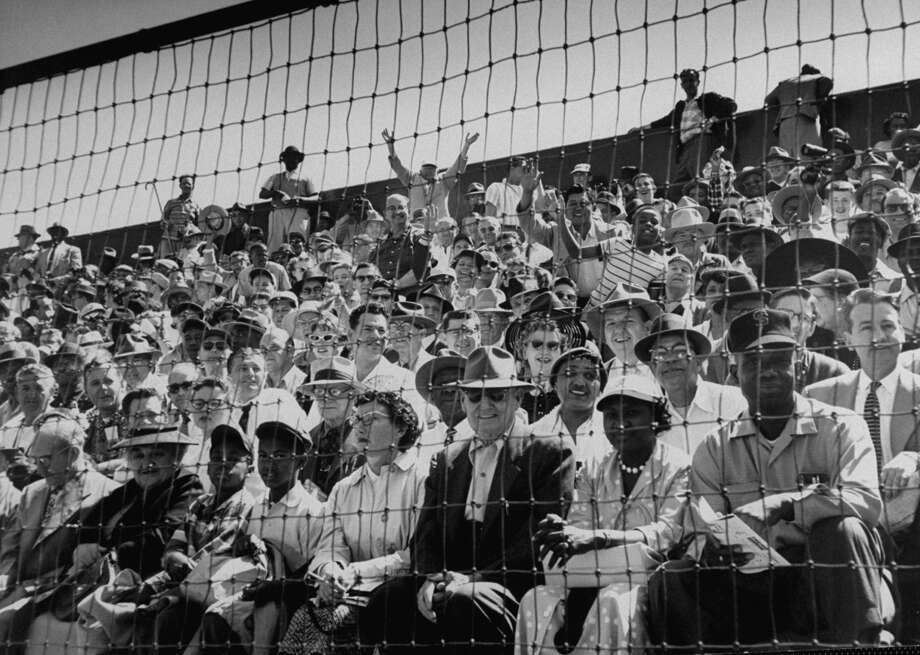 1950s:Baseball fans during the opening game between the San Francisco Giants and Los Angeles Dodgers in 1958. Photo: Leonard McCombe/The LIFE Picture Collection/Getty Images