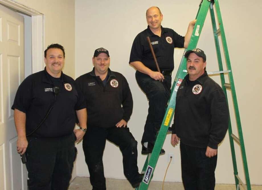 Cleveland firefighters Sean Anderson, John Murphy, Doug Castleberry and Travis Strickland, along with Chief Brian McNevin, who has been overseeing the project, have been working hard on improvements to Station 2, which is located on Boothe St. Photo: VANESA BRASHIER