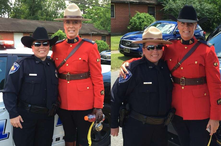 Roman Forest Police Officer Carmen Smith traded uniform hats with Royal Canadian Mounted Police Officer Sarah Wilkin.