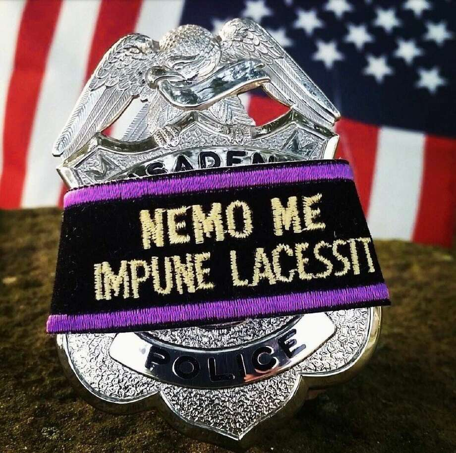 The Latin words translate to 'No one can harm me with impunity.' Photo: Pasadena Police