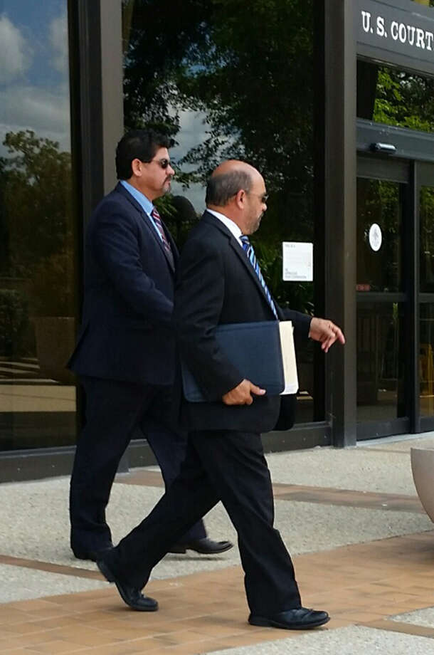 Samuel Mullen (left), who is alleged to have bribed an insurance consultant for area school districts, walks out of federal court today in San Antonio with his lawyer, David R. Gorena (right). Mullen entered a not guilty plea to a charge of conspiracy to commit fraud through bribery. Photo: /Guillermo Contreas /Staff / San Antonio Express-News