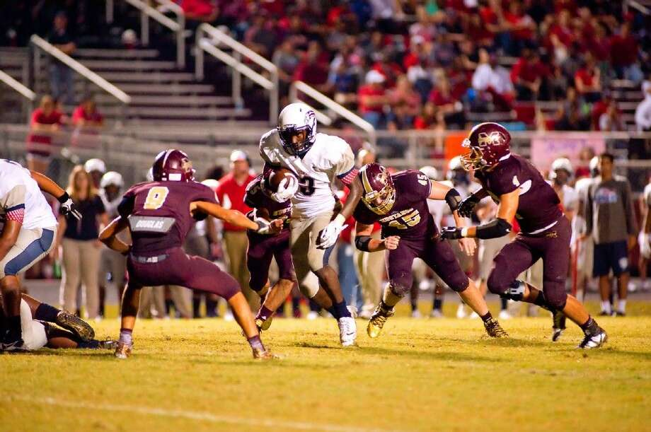 Staff Photo By Tony GainesMagnolia West players surround a Pearland Dawson player on Friday night in a 61-50 loss to the Eagles.