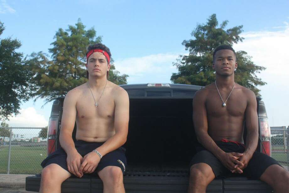 Lots of high school football players have been working out on their own, preparing for the start of formal workouts either tomorrow or the following Monday. Among those getting a jump on fall practices has been the Memorial duo of Bubba Baxa (left) and Alex Williams. Photo: Robert Avery
