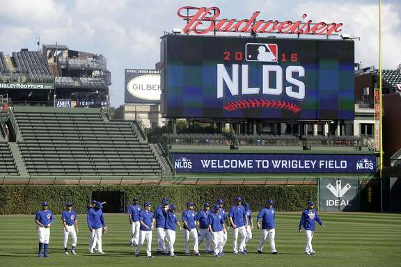Chicago Cubs players warm up during baseball practice at Wrigley Field, Wednesday, Oct. 5, 2016, in Chicago. The Cubs host the winner of Wednesday's National League wild-card game between the New York Mets and San Francisco Giants on Friday, in Game 1 of the National League Division Series . (AP Photo/Kiichiro Sato)