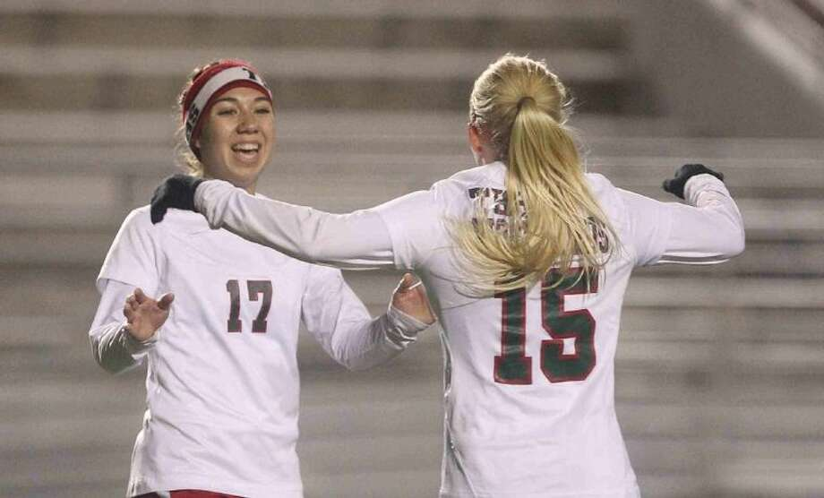 The Woodlands' Carmen Webster (17) celebrates with Stephanie Evans after Webster's goal against Conroe on Wednesday at Woodforest Bank Stadium in Shenandoah. To view or purchase this photo and others like it, visit HCNpics.com.