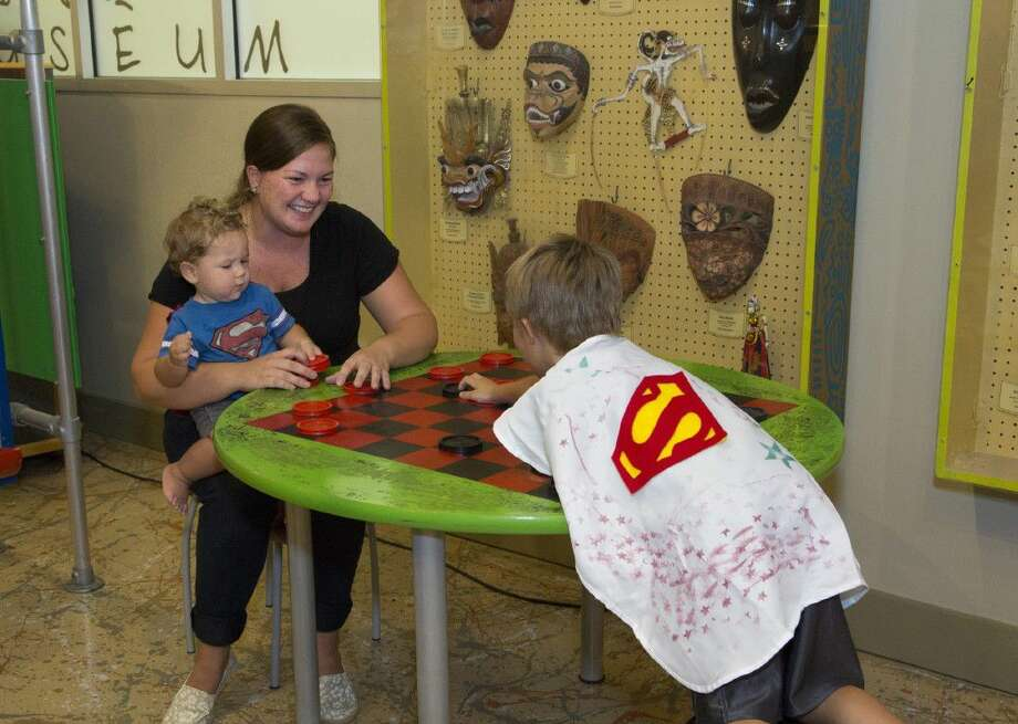 The Woodlands Children's Museum invites parents to let their own, personal super heroes perform feats of caring at its annual Super Hero Day on Friday, Aug. 12. Photo: Courtesy Photo