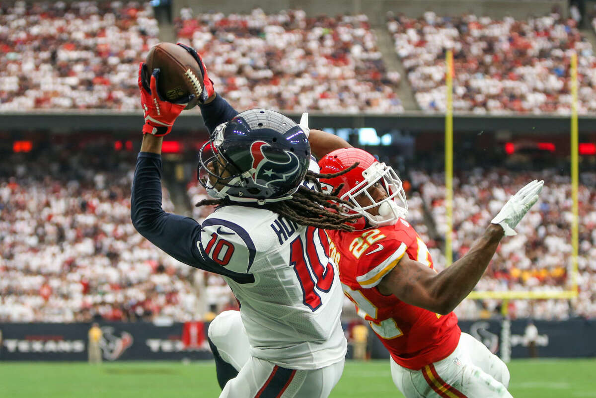 Houston Texans wide receiver DeAndre Hopkins catches a touchdown pass from quarterback Brian Hoyer as Kansas City Chiefs cornerback Marcus Peters defends in the first quarter of the NFL football game on Sunday, Sept. 13, 2015, in Houston, Texas.