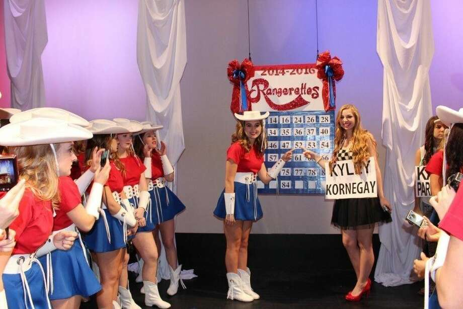 Deer Park Graduate Kyley Kornegay points to her tryout number with the Kilgore Rangerettes at the Historic Kilgore Rangerettes sign drop ceremony at Dodson Auditorium at Kilgore College. Photo: Submitted Photo