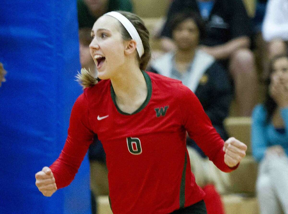 The Woodlands Courtney Heiser celebrates a point during a volleyball game. To view or purchase this photo and others like it, visit HCNpics.com.