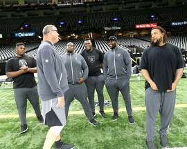 Offensive line coach Mike Tice knows when to put his foot down and when to ease up