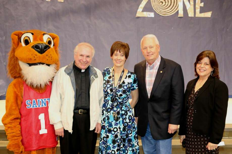 Suzanne Barto, center, with Father Drew, St. Laurence Pastor, school mascot Leo the Lion, James Thompson, Sugar Land Mayor, and Germaine Guedry, MS Assistant Principal. Photo: Submitted Photo