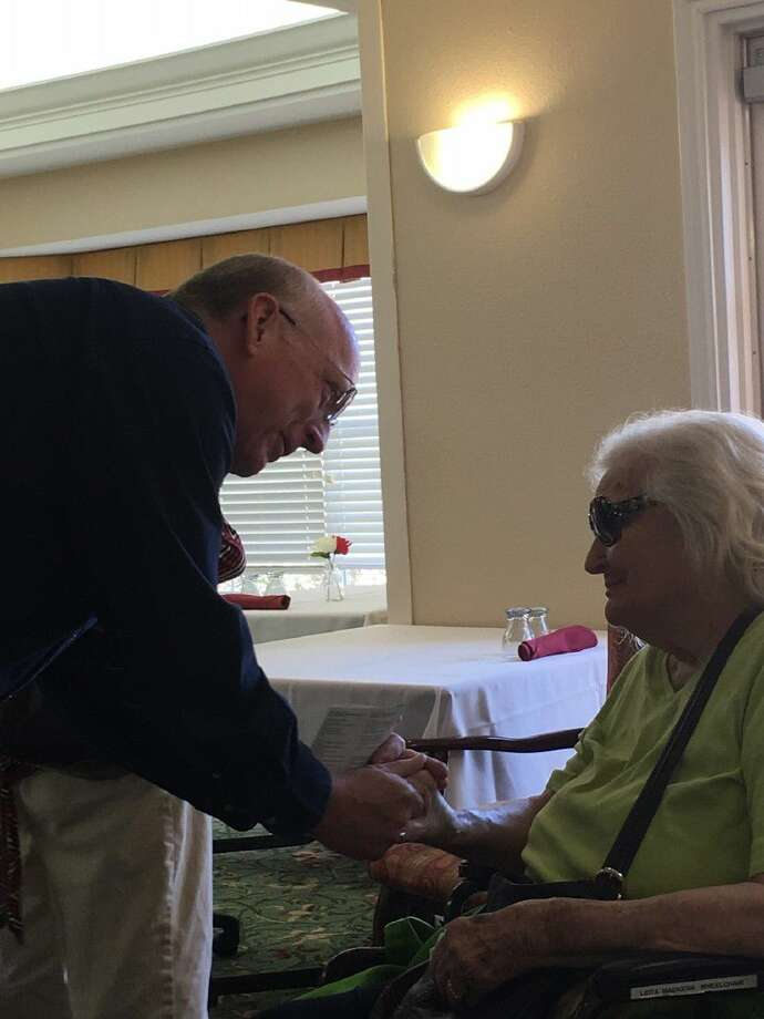 Parkway Place Chaplain John Bender visits with a resident during activities at the senior living community. Photo: Submitted Photo